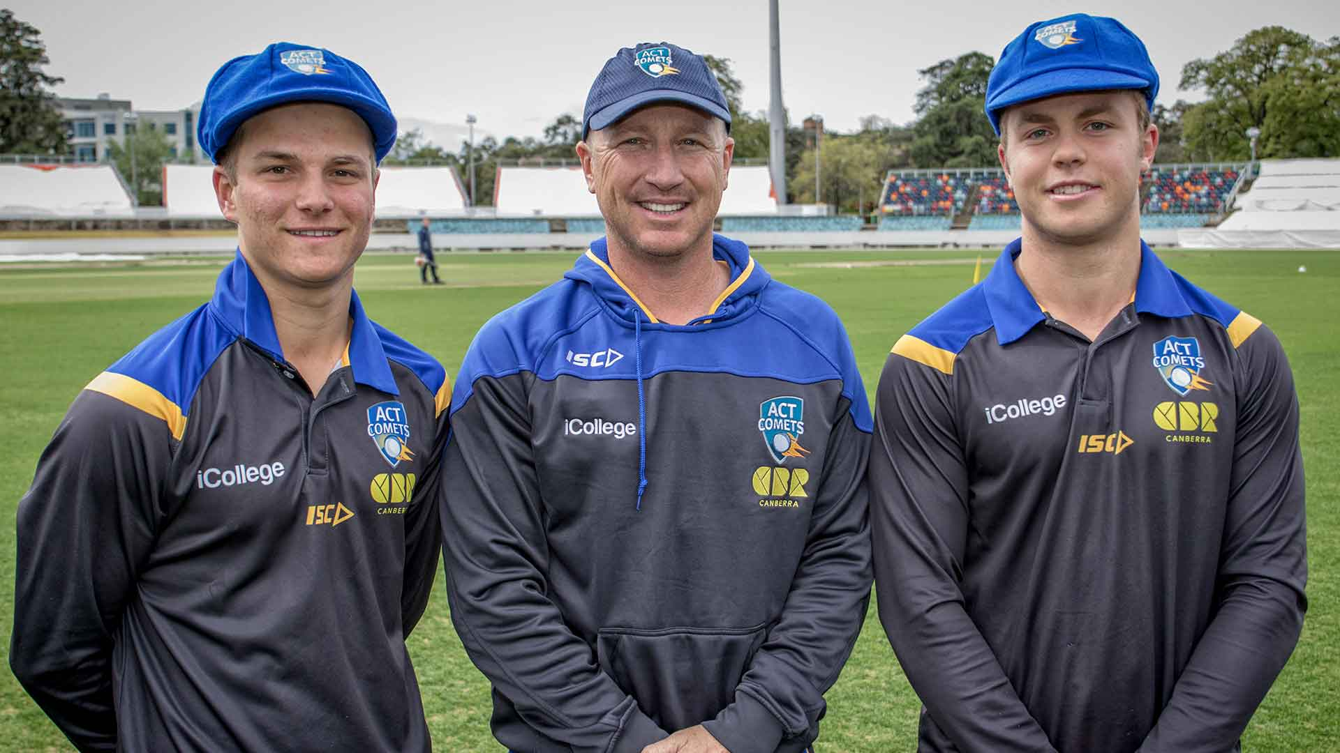 Comets and Australian legend Brad Haddin conducts the cap presentation for iCollege ACT Comets debutants Tom Vane-Tempest and Daniel Solway.